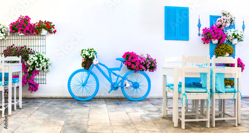Charming street (outdoor) decoration with old bicycle and flowers. Bodrum, Turkey