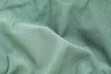 The Background Texture Is A Green Soft Wavy Fabric, Top View, Close-up.
