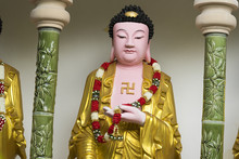 Standing Buddha Figure With A ...
