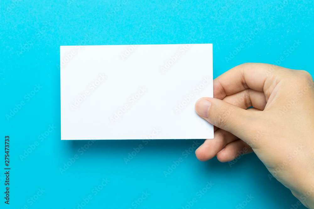 Fototapety, obrazy: Hand holding up a note card on a blue background
