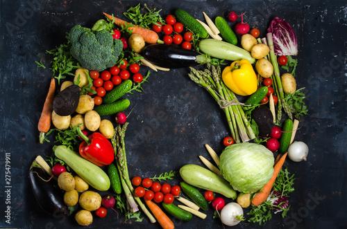 Fotobehang Frame of organic food. Fresh raw vegetables on a black chalkboard.