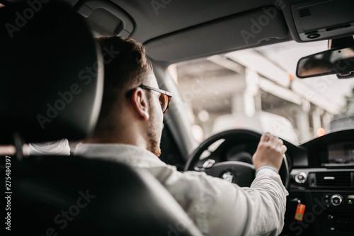driver businessman rides a business class car through the city in sunglasses Fototapete