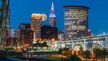 Big Moon Rising Over Skyline In Small City America With Bright Lights And Iconic Bridge, Cleveland Ohio