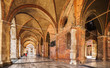 canvas print picture - Arcades of the Gothic palace in the center of Piacenza