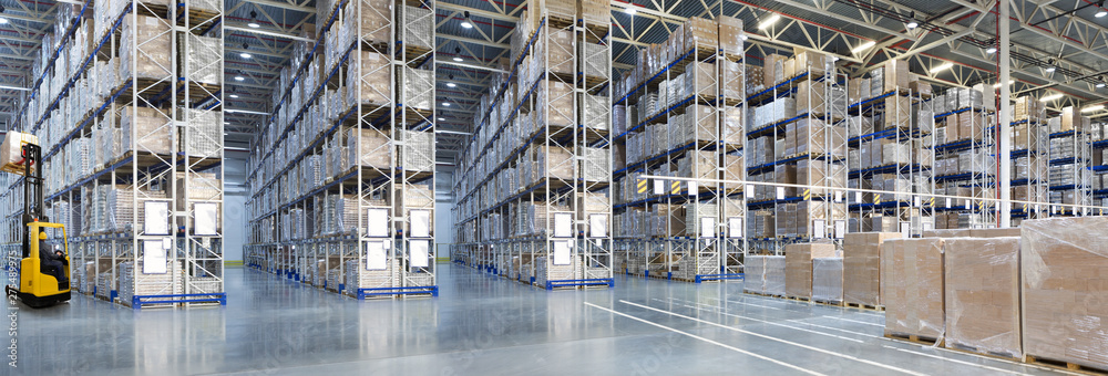 Fototapety, obrazy: Huge distribution warehouse with high shelves and forklift