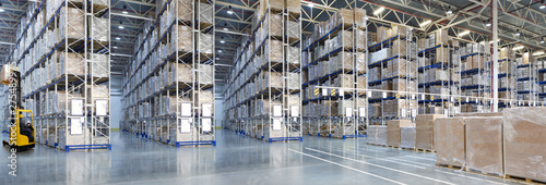 Obraz Huge distribution warehouse with high shelves and forklift - fototapety do salonu