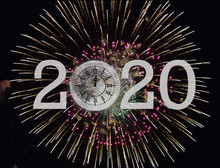 New Year 2020 Clock With Midnight Time On Full Moon With Fireworks Display On Black Sky Background
