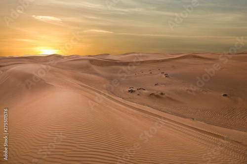 Foto  Sand dessert sunset landscape view, UAE
