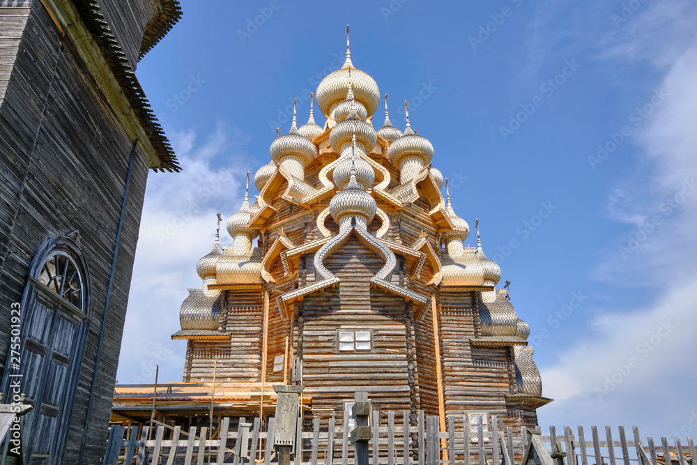Fototapety, obrazy: Scenic view of wooden orthodox church of  Transfiguration of the Lord on Kizhi island on Onezhsky lake in Russian Federation. Beautiful summer look of traditional temple of russian North in Karelia