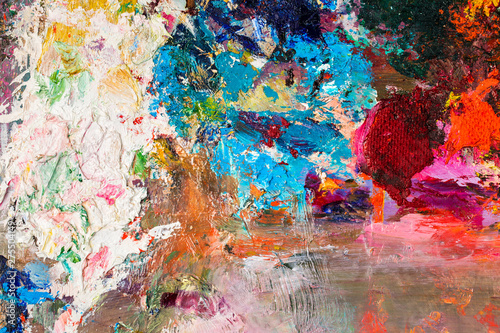 Background image of bright oil-paint palette closeup.