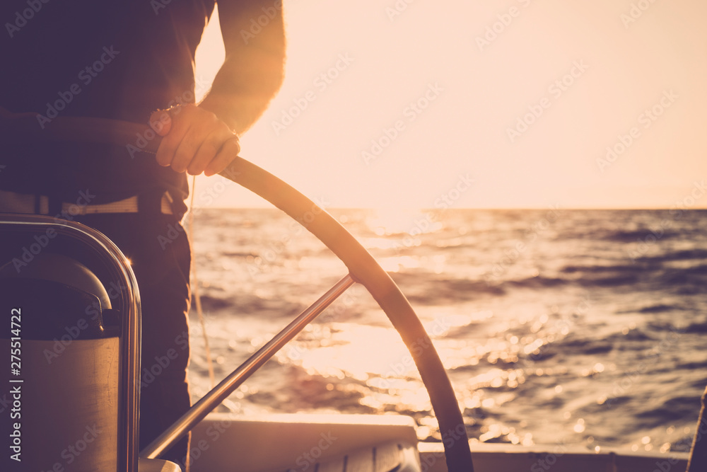 Fototapety, obrazy: Close up of man's hand on sail boat helm - marine ship lifestyle concept of travel for beautiful holiday destination - alternative people life - sunset and sunlight in background on the ocean