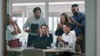 group of business people celebrating success watching laptop screen happy colleagues applause enjoying successful corporate victory achievement in modern office 4k