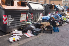 Rows Of Garbage Containers With Trash And Package On The Street In Rome In Italy