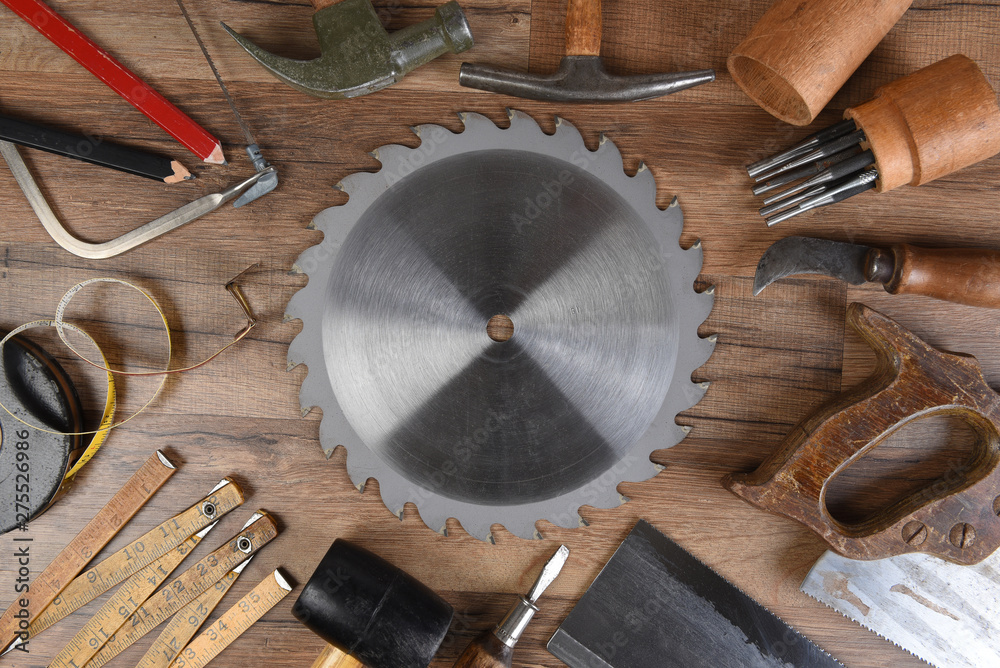 Fototapety, obrazy: High angle closeup of a large group of tools arranged around a round table saw blade