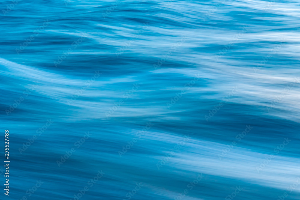 Fototapety, obrazy: Gentle soothing silky flowing natural ocean water movement. Abstract background motion blur. Serene and peaceful deep blue sea in nature.