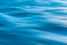 Gentle Soothing Silky Flowing Natural Ocean Water Movement. Abstract Background Motion Blur. Serene And Peaceful Deep Blue Sea In Nature.