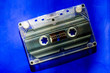 canvas print picture - compact  cassette on a blue background. Old  tape cassette