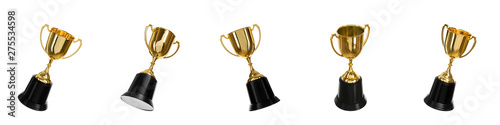Photo Set of shiny gold trophy cups on white background. Banner design