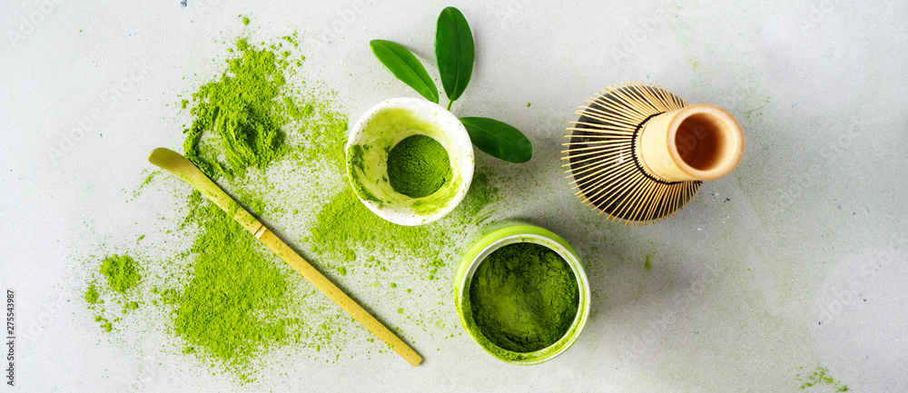 Fototapety, obrazy: Flat lay of organic Japanese green tea and tools Chasen bamboo whisk, Chashaku spoon and bowl for brewing background with copy space. Long banner.