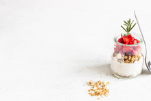 Breakfast With Yogurt, Granola And Fresh Strawberry In A Mason Jar On A Light Stone Background. Healthy Breakfast Or Dessert Concept, Selective Focus. Copy Space.