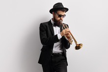 Bearded Guy Playing A Trumpet