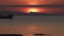Ship Sailing In Ocean Fjord Colorful Sunset Behind Mountains Reykjavik Iceland.mov