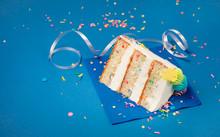 Slice Of Birthday Cake On Blue