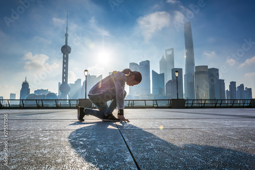 Woman running at Shanghai bund in the morning,landmark of Shanghai Canvas Print