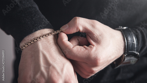 Photographie Man with a expensive bracelet. Fashion accessories and jewelry