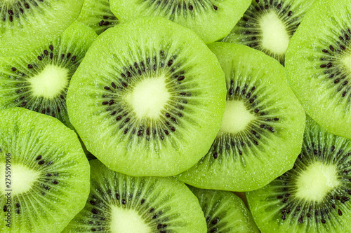 beautiful kiwi fruit slices background. - 275590906