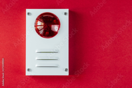 Poster Macarons Fire safety system on a red background of a copy space