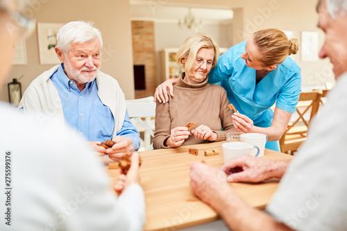Photo  Caregiver cares for a senior woman with dementia