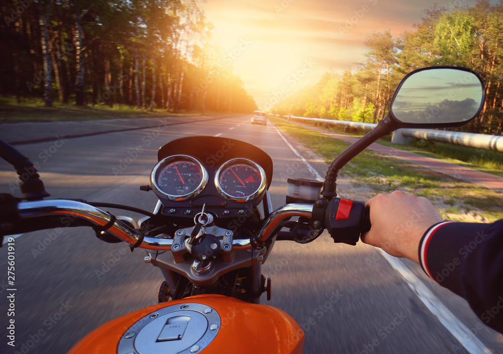 Fototapety, obrazy: Motorcyclist drives motorbike on a sunny day on the street