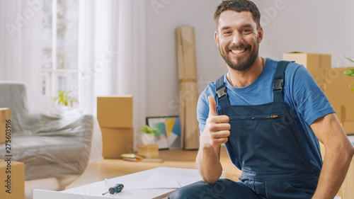 Successful Furniture Assembly Worker Finishes Assembling Shelf and Shows Thumbs Up Smilingly Canvas Print