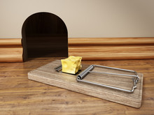 Mouse Trap With A Piece Of Cheese Standing In Front Of The Mouse Hole. 3D Illustration