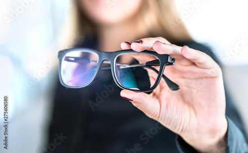Fotografía Optician, optometrist, oculist or eye doctor holding glasses and specs with new lenses