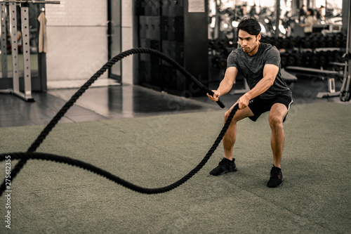 Fototapety, obrazy: Fit young man workout in a gym