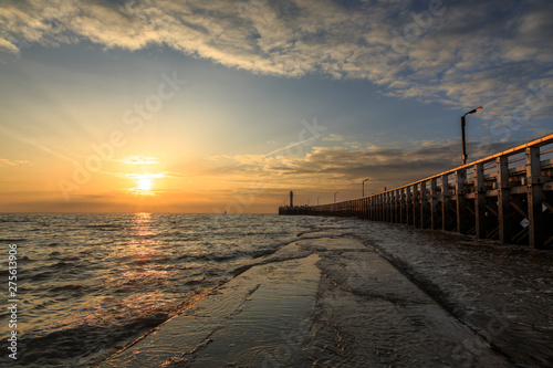 Fototapeten Natur Sunset on the pier in Nieuwpoort on the Belgian Coast, Belgium