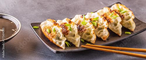 gyoza or dumplings snack with soy sauce Wallpaper Mural