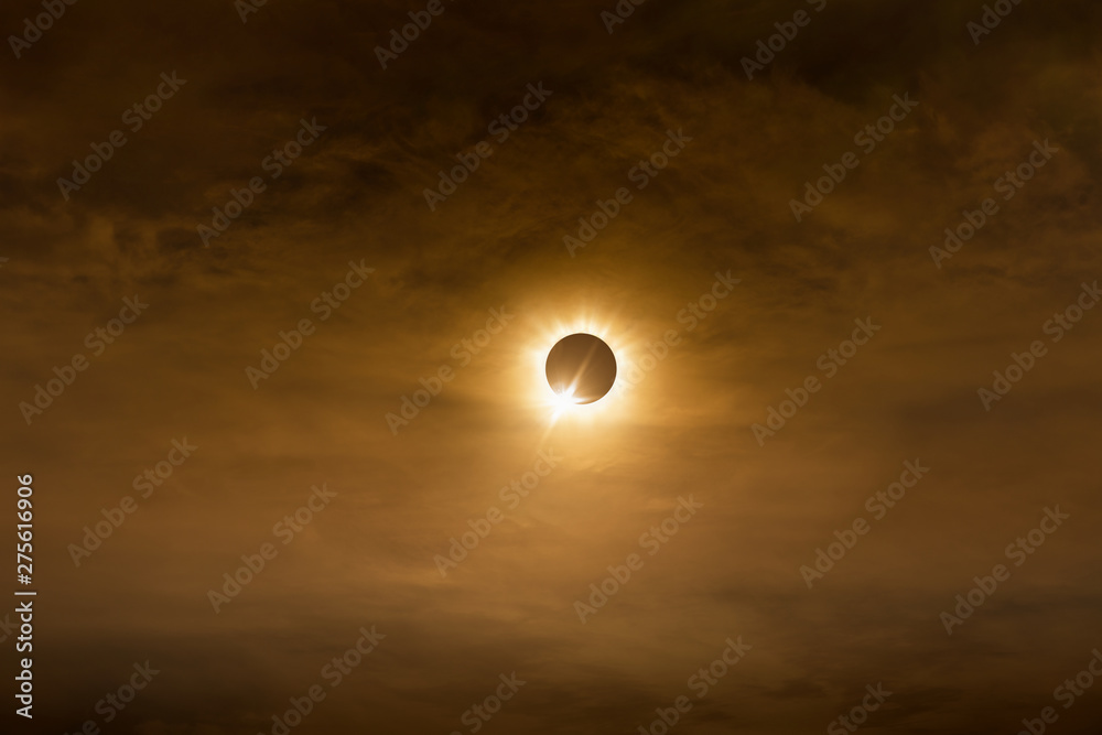 Fototapety, obrazy: Total solar eclipse in dark red cloudy sky