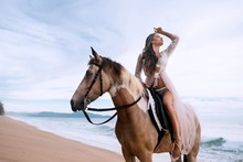 Young Brunette Beauty Having Fun And Riding Horse On The Beach