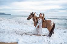 Woman In Formal Dress In Ocean...