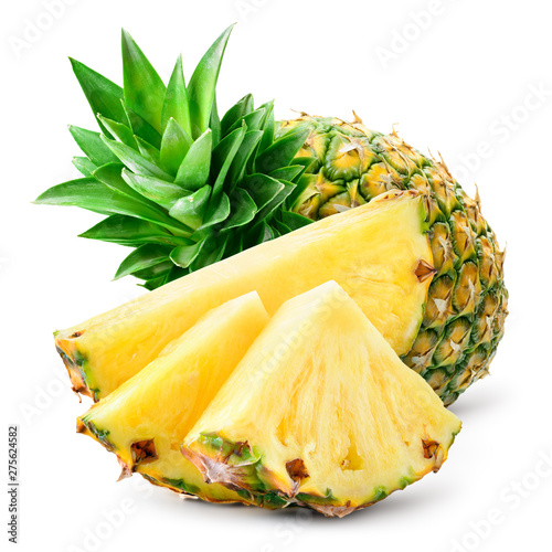Carta da parati Pineapple slices and whole pineapple on background