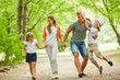Family and kids go for a walk