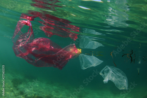 Plastic bags, bottles, straws and cups pollution of ocean