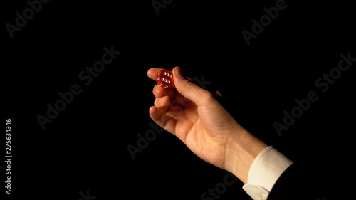 Photo  Hand showing dice against black background, risk and success in gambling, casino