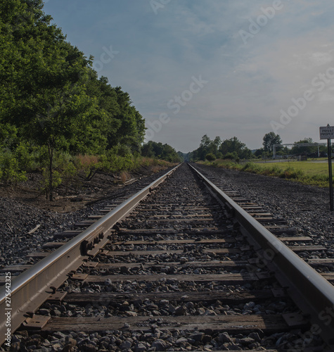 Photo Stands Railroad railway leading into he blue sky