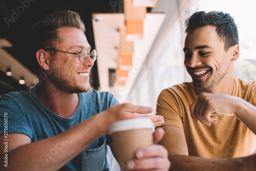 Excited Caucasian hipster guys feeling great during friendly meeting in cafeteri Canvas-taulu
