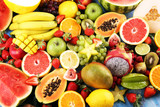 Tropical fruits background, many colorful ripe fresh tropical fruits