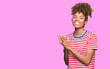 canvas print picture - Beautiful young african american woman over isolated background Clapping and applauding happy and joyful, smiling proud hands together